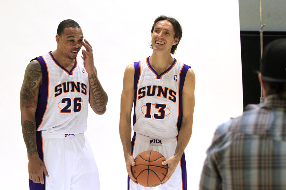 Phoenix Suns\' Steve Nash (13) and new teammate Shannon Brown (26) pose for photos during an NBA basketball media day on Friday, Dec. 16, 2011, in Phoenix. (AP Photo/Ross D. Franklin)