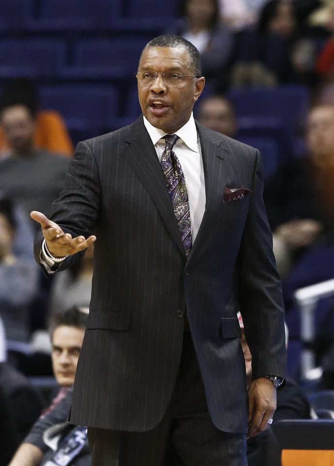 Photo - In this photo taken Thursday, Jan. 17, 2013, Phoenix Suns' head coach Alvin Gentry argues with officials during an NBA basketball game against the Milwaukee Bucks, in Phoenix.  After five-plus seasons, Gentry is stepping down as head coach today as Gentry and the team