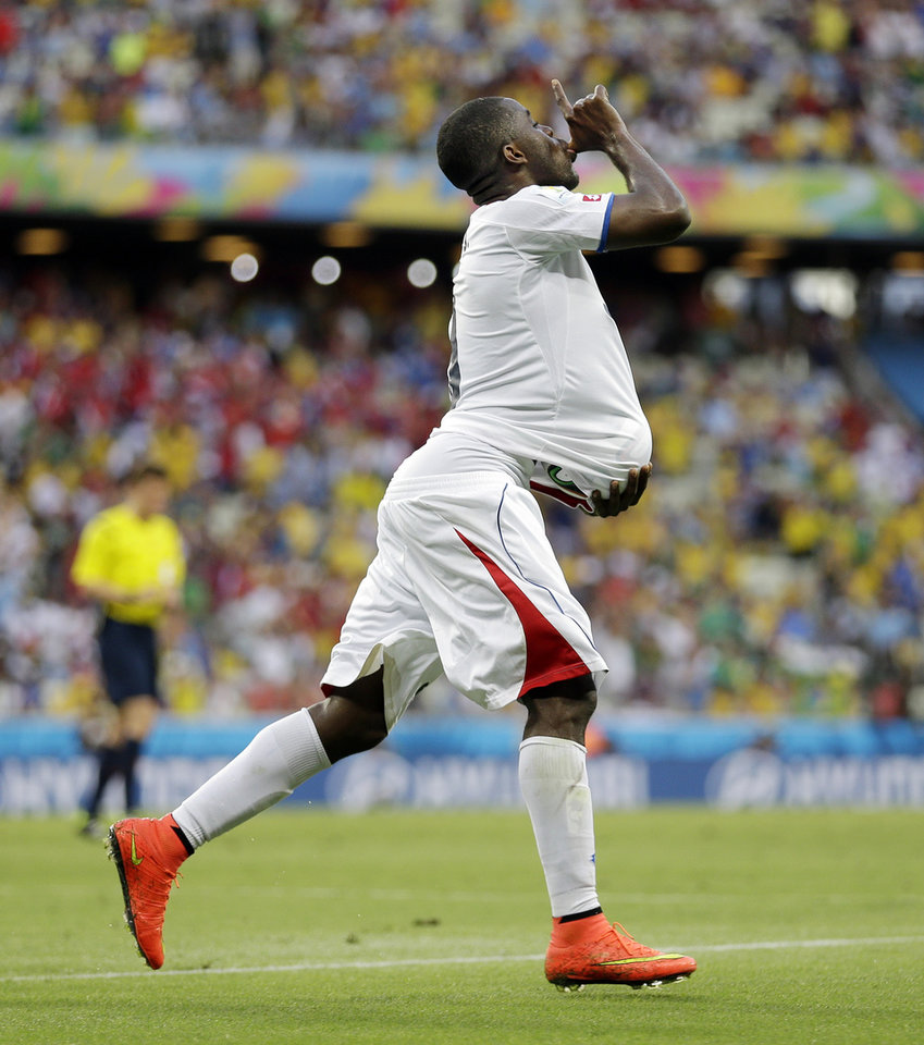 Photo - Costa Rica's Joel Campbell runs with the ball under his shirt after scoring his side's first goal during the group D World Cup soccer match between Uruguay and Costa Rica at the Arena Castelao in Fortaleza, Brazil, Saturday, June 14, 2014.  (AP Photo/Natacha Pisarenko)