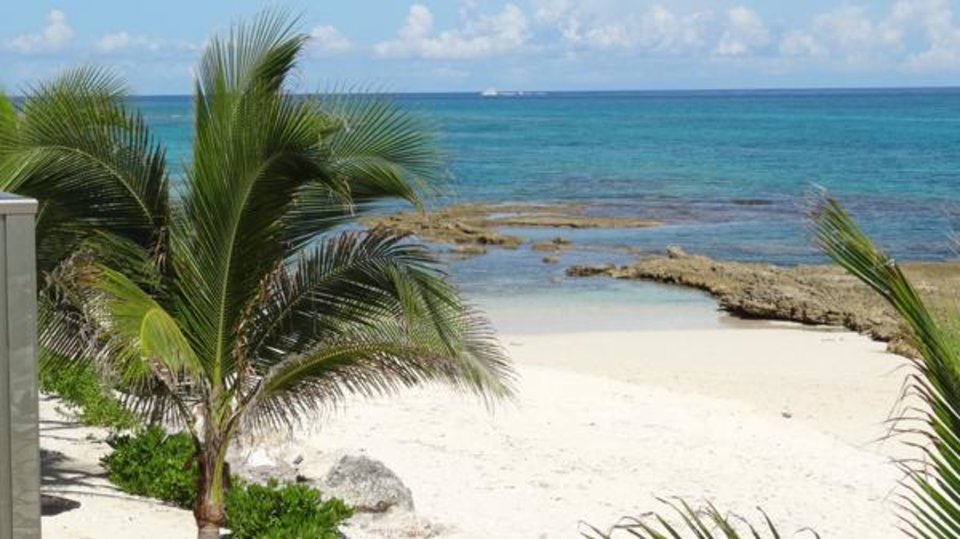Photo -       View the Caribbean blue waters from the condo balcony.