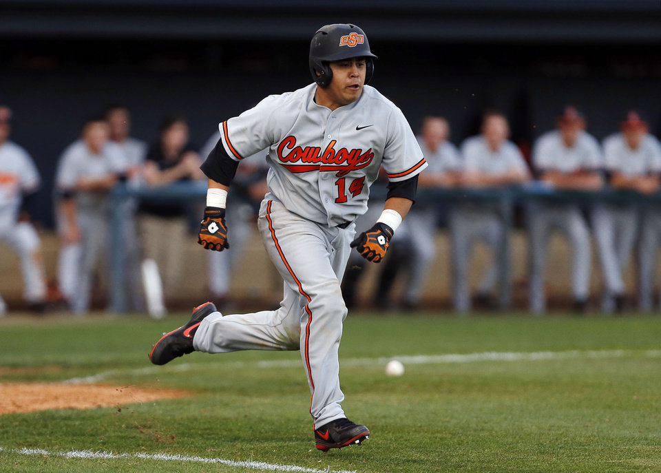 Photo - OSU's Robie Rojas runs to first base during the OSU-ORU baseball game at J.L. Johnson Stadium, on Tuesday, April 22, 2014. CORY YOUNG/Tulsa World