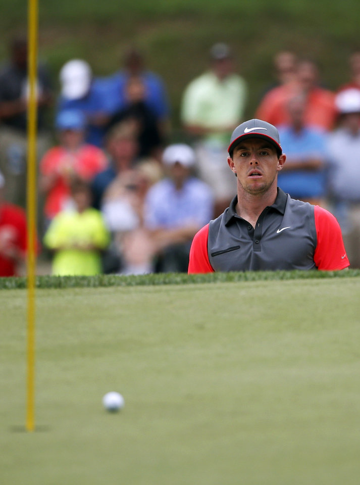 Photo - Rory McIlroy, of Northern Ireland, watches shot out of the bunker on the sixth hole during the first round of the PGA Championship golf tournament at Valhalla Golf Club on Thursday, Aug. 7, 2014, in Louisville, Ky. (AP Photo/Mike Groll)