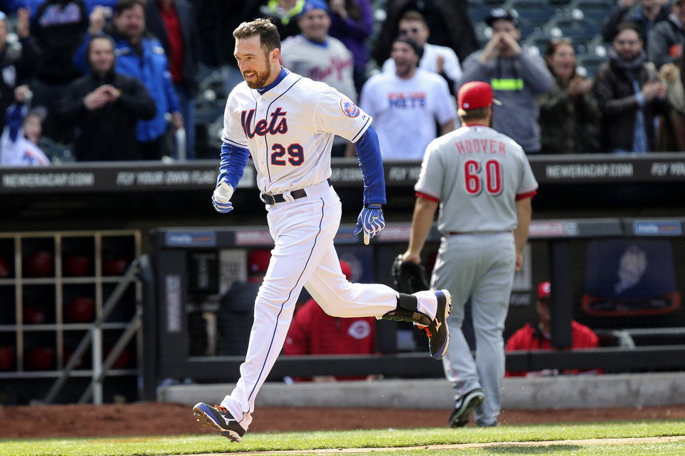Photo - New York Mets first baseman Ike Davis (29) runs home after hitting a walk-off grand slam off of Cincinnati Reds relief pitcher J.J. Hoover (60) in the ninth inning of a baseball game against the Cincinnati Reds at Citi Field, Saturday, April 5, 2014, in New York. The Mets won 6-3. (AP Photo/John Minchillo)