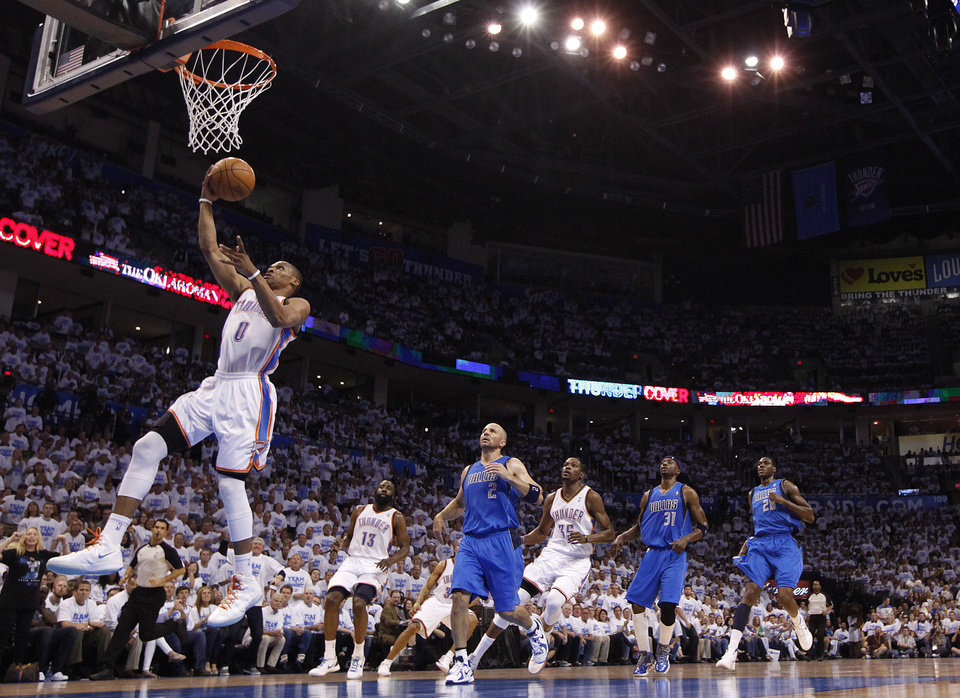 Oklahoma City's Russell Westbrook (0) shoots a lay up during Game 2 of the first round in the NBA basketball playoffs between the Oklahoma City Thunder and the Dallas Mavericks at Chesapeake Energy Arena in Oklahoma City, Monday, April 30, 2012. Photo by Sarah Phipps, The Oklahoman