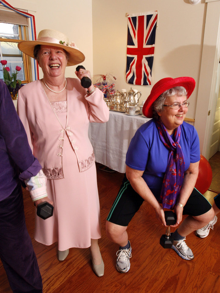 Photo - Wendy Mahoney, left, and Cecille Gregoire lift dumbbells as they exercise at Age Right Fitness in Hallowell, Maine, while watching the wedding of Britain's Prince William and Kate Middleton on a television Friday, April 29, 2011. Some 2 billion people across the globe were believed to have tuned in as the future king and queen of England started their lives as husband and wife with the two simple words