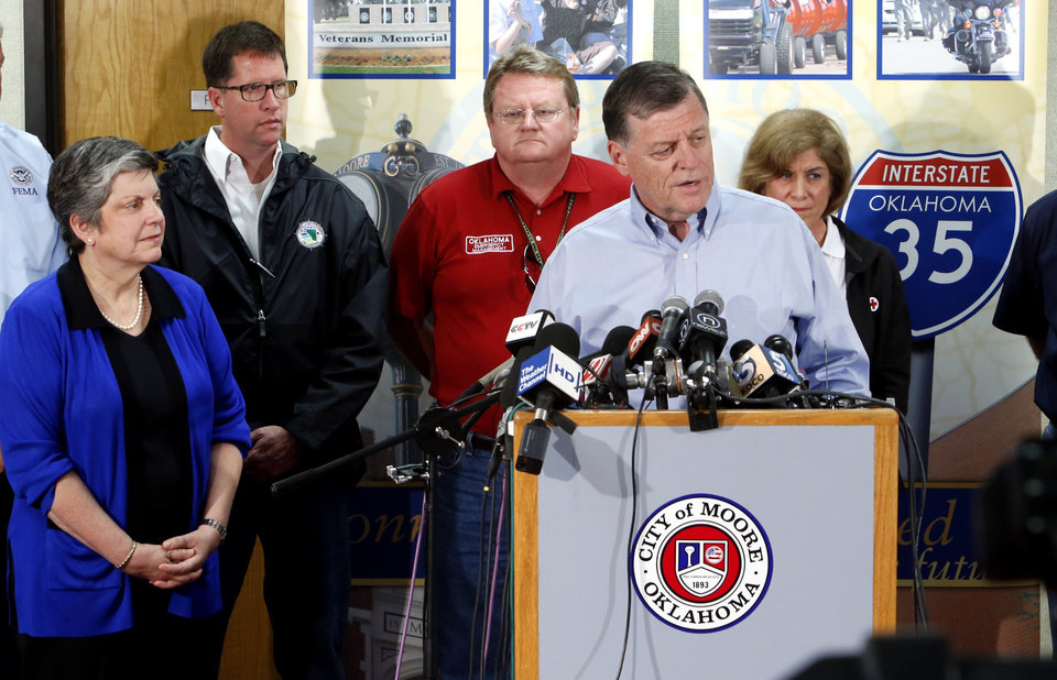 United State Secretary of Homeland Security Janet Napolitano, left, Cleveland County Commissioner Darry Stacy, Oklahoma Emergency Management Director Albert Ashwood, Senator Tom Cole, and Gail McGovern with the American Red Cross speak with the media at a press conference concerning damage from Monday\'s tornado on Wednesday, May 22, 2013 at city hall in Moore, Okla. Behind left is . Photo by Steve Sisney, The Oklahoman