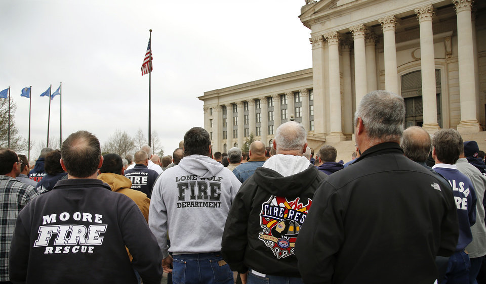 An estimated 400 active and retired firefighters from across Oklahoma rallied on the south plaza of the state Capitol Monday morning, March 18, 2013, before going inside the building to visit with lawmakers and voice their concerns about proposed changes in pension and workers' compensation systems.      Photo by Jim Beckel, The Oklahoman