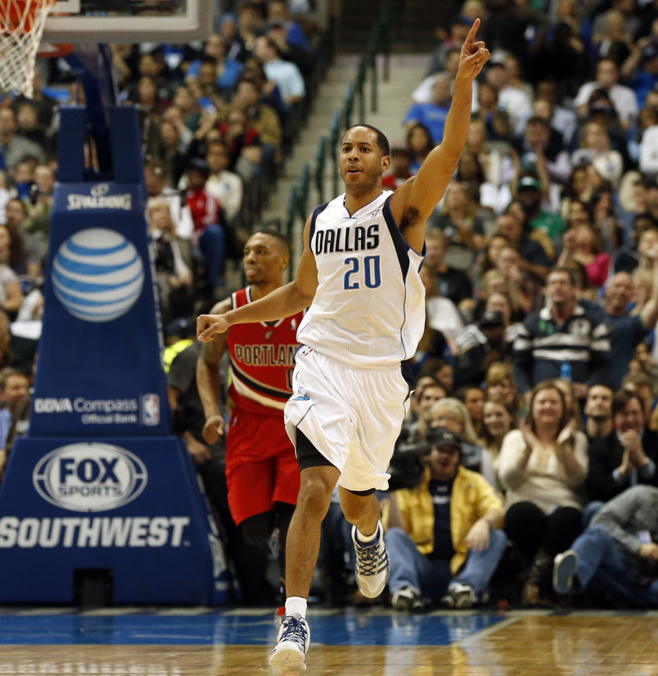 Photo - Dallas Mavericks guard Devin Harris (20) celebrates after making a basket during the first half of an NBA basketball game against the Portland Trail Blazers, Friday, March 7, 2014, in Dallas. (AP Photo/John F. Rhodes)