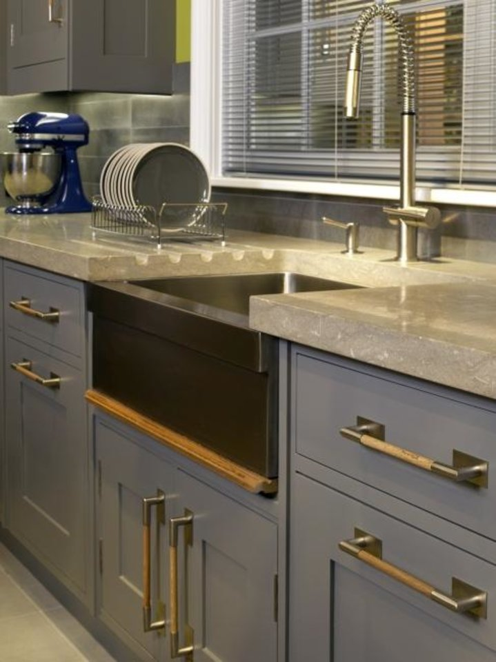 Photo -  A Christopher Peacock-designed kitchen features an integrated dish draining board. [CHRISTOPHER PEACOCK]