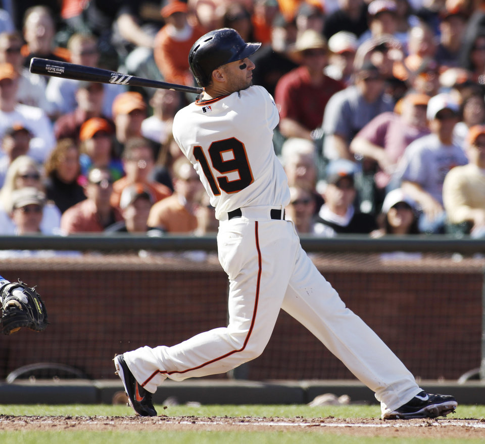 Photo - San Francisco Giants' Marco Scutaro hits a sacrifice fly against the Los Angeles Dodgers during the second inning of a baseball game in San Francisco, Saturday, July 6, 2013. (AP Photo/George Nikitin)