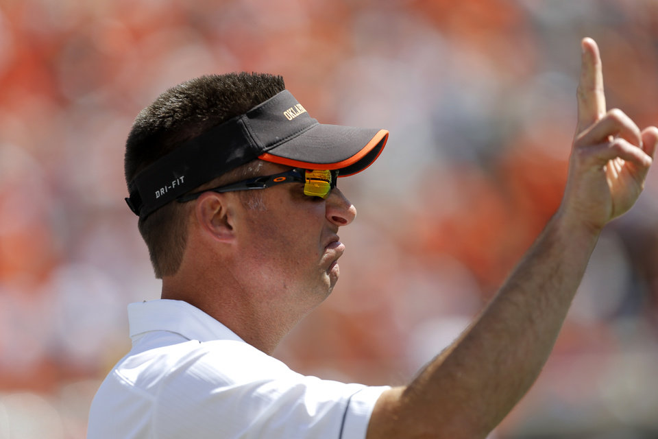 Oklahoma State coach Mike Gundy signals during OSU\'s spring football game at Boone Pickens Stadium in Stillwater, Okla., Sat., April 20, 2013. Photo by Bryan Terry, The Oklahoman