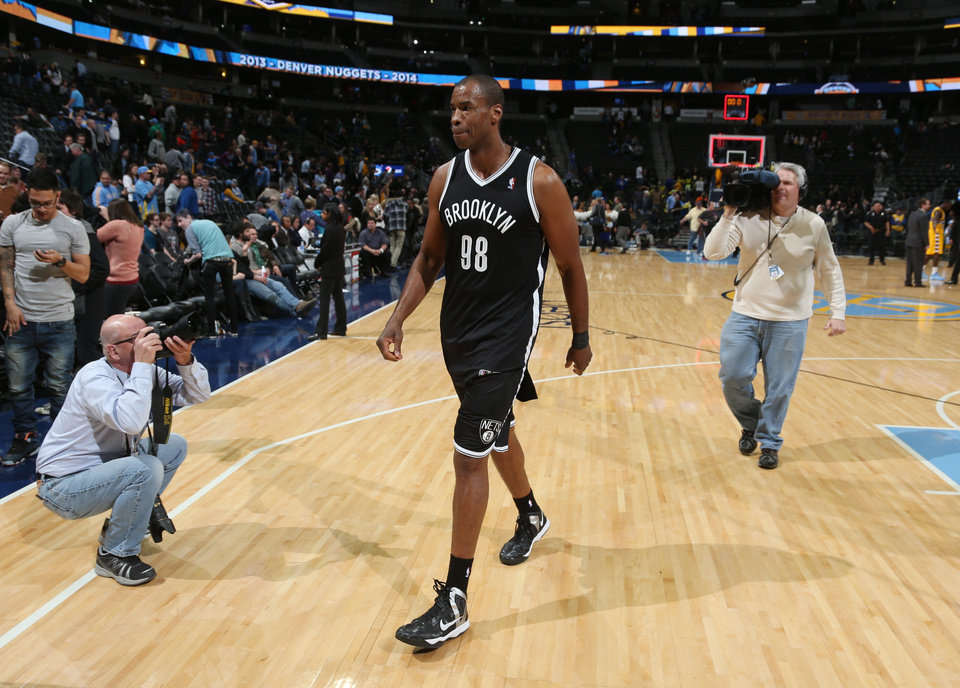 Photo - Brooklyn Nets center Jason Collins heads off the court after the Nets' 112-89 victory over the Denver Nuggets in an NBA basketball game in Denver on Thursday, Feb. 27, 2014. (AP Photo/David Zalubowski)