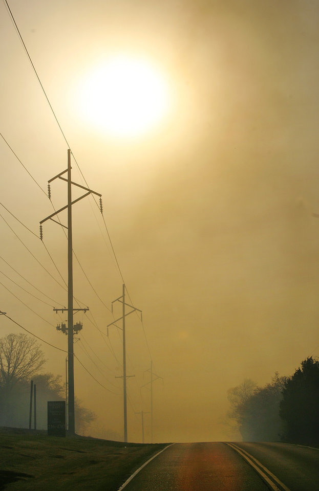 Photo - Late afternoon sun is obscured by heavy smoke as a result of multiple fires sparked by wildfires in Midwest City, Okla.,  Thursday, April 9, 2009.  Photo by Jim Beckel, The Oklahoman