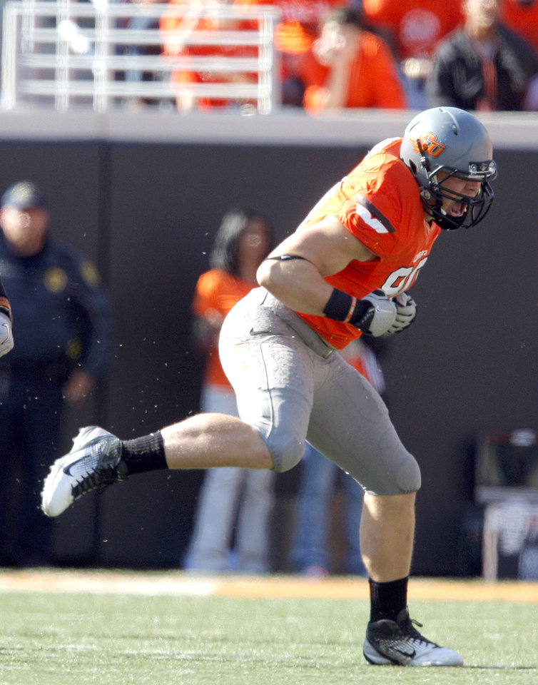 Photo - Oklahoma State's Cooper Bassett (80) celebrates a sack during a college football game between the Oklahoma State University Cowboys (OSU) and the Baylor University Bears (BU) at Boone Pickens Stadium in Stillwater, Okla., Saturday, Oct. 29, 2011. Photo by Sarah Phipps, The Oklahoman