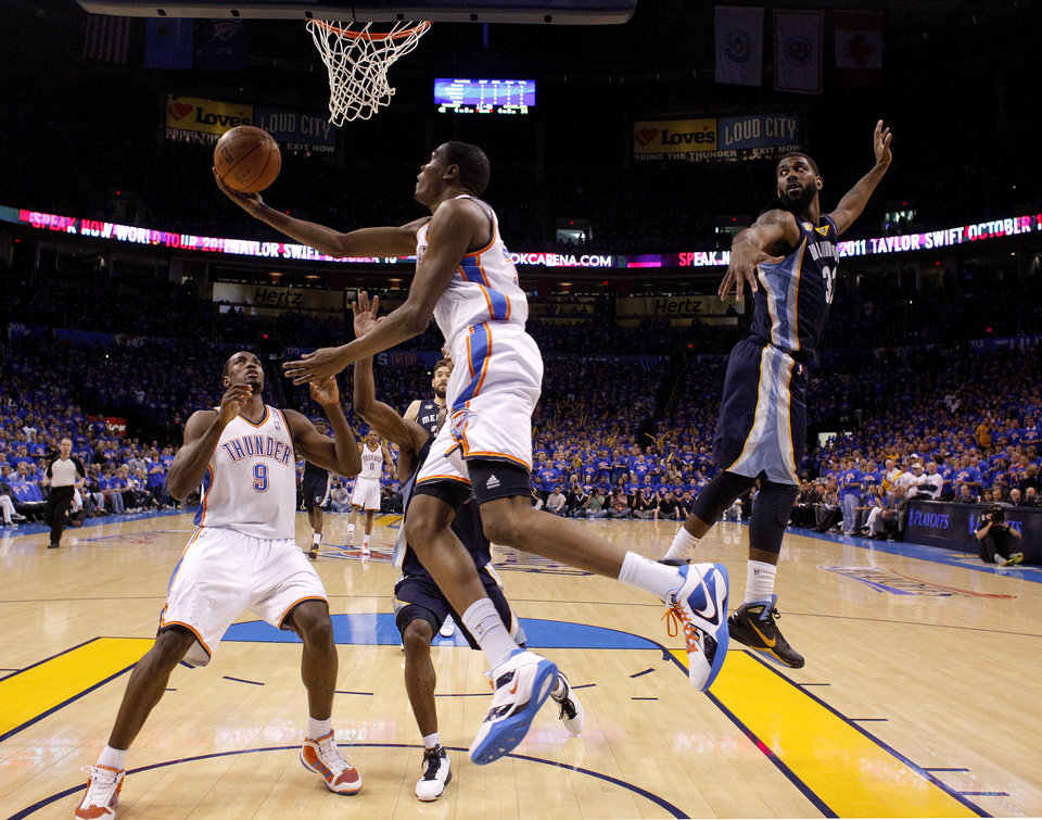 Photo - Oklahoma City's Kevin Durant (35) shoots as O.J. Mayo (32) of Memphis defends during game 7 of the NBA basketball Western Conference semifinals between the Memphis Grizzlies and the Oklahoma City Thunder at the OKC Arena in Oklahoma City, Sunday, May 15, 2011. Photo by Sarah Phipps, The Oklahoman