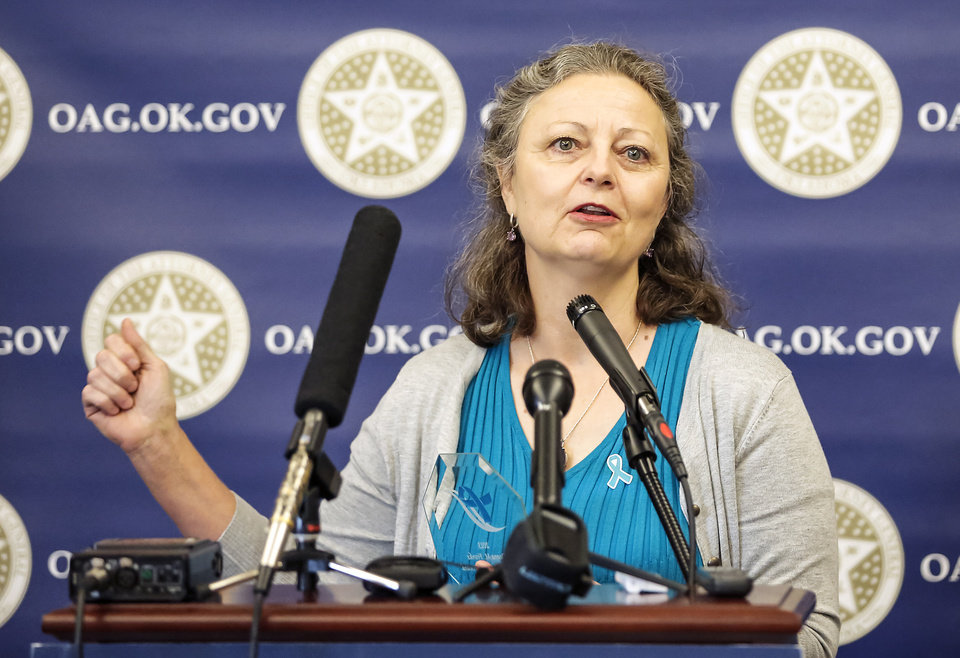 Deana Franke speaks after being presented the Moving Upstream Award for her role in helping victims of sexual assault during a ceremony to advocate Sexual Assault Awareness Month at the Attorney General's office on Monday, April 8, 2013, in Oklahoma City, Okla.