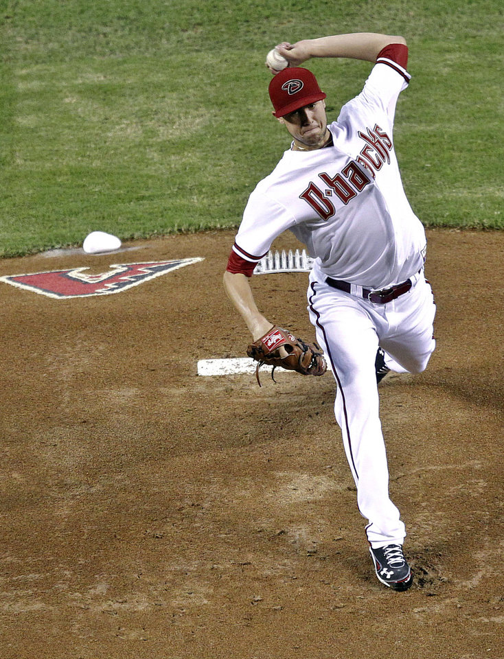 Photo -   Arizona Diamondbacks pitcher Tyler Skaggs throws against the San Francisco Giants during the first inning of a baseball game on Friday, Sept. 14, 2012, in Phoenix. (AP Photo/Matt York)