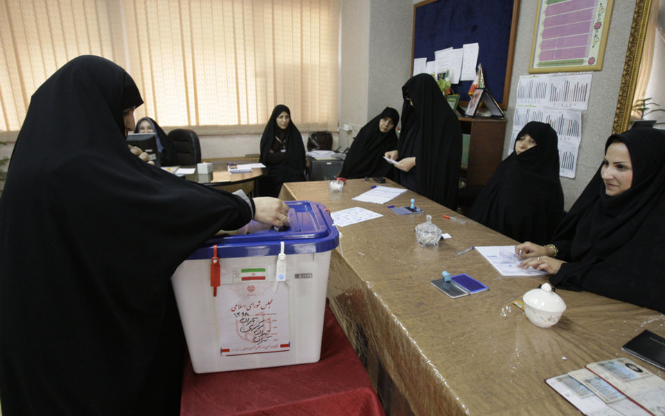 Photo -   An Iranian woman casts her ballot for the parliamentary runoff elections, in a polling station, in Tehran, Iran, Friday, May 4, 2012. The country has begun runoff elections for more than one-fifth of parliamentary seats. Friday's report says 130 hopefuls will compete for 65 seats in 33 constituencies including the capital Tehran with 25 undecided seats. (AP Photo/Vahid Salemi)