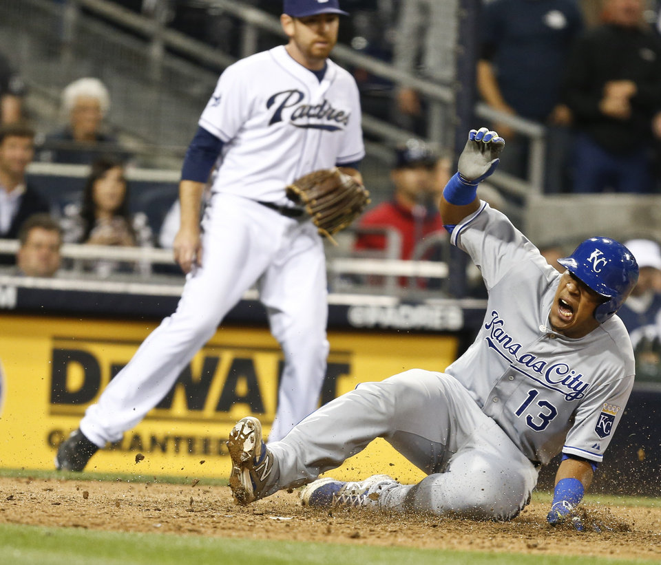 Photo - Kansas City Royals' Salvador Perez lets out a yell after beating throw home to  score the go ahead run in the 12th inning of a baseball game against the San Diego Padres Monday, May 5, 2014, in San Diego.  (AP Photo/Lenny Ignelzi)