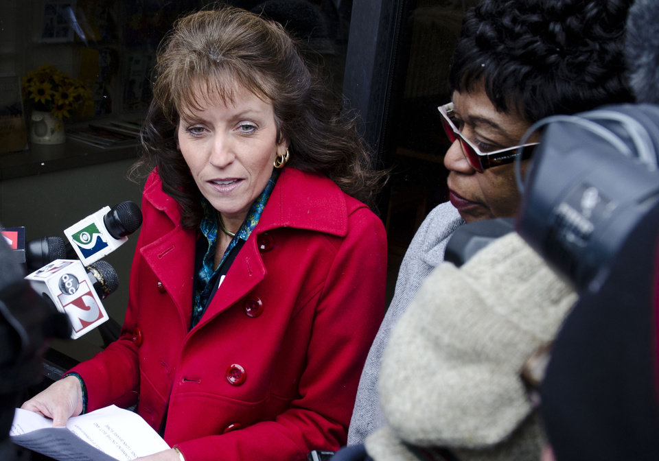 """Photo - FILE - In this Feb. 19, 2013 file photo Melany Gavulic, CEO and president of Hurley Medical Center, makes a statement duirng a protest  outside Hurley Medical Center in Flint, Mich. after a nurse filed a complaint against the hospital claiming it had agreed to a man's request that no African-American nurses care for his newborn. The case involving a white swastika-tattooed Michigan father and a black nurse at the hospital highlights one of medicine's """"open secrets"""" _ allowing patients to refuse treatment by a doctor or nurse of another race. The nurse is now suing the hospital, claiming it bowed to his illegal demands. (AP Photo/The Flint Journal, Lauren Justice, File) LOCAL TV OUT; LOCAL INTERNET OUT"""