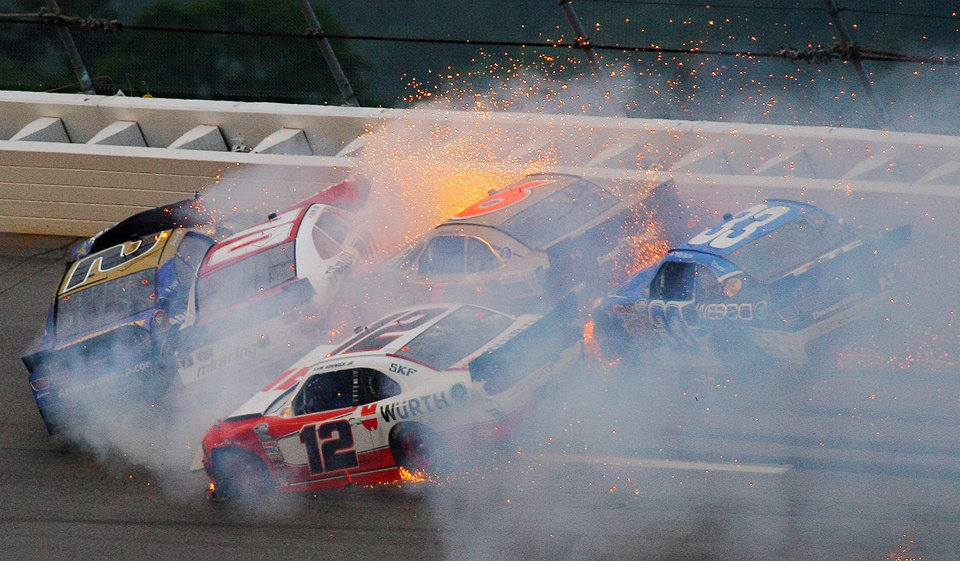 Photo - Brian Scott (2) crashes with Johanna Long (70), Trevor Bayne (6), Ty Dilon (33) and Sam Hornish Jr. (12) in Turn 3 during the NASCAR Nationwide Series auto race at the Talladega Superspeedway in Talladega, Ala., Saturday, May 4, 2013. (AP Photo/Greg McWilliams)