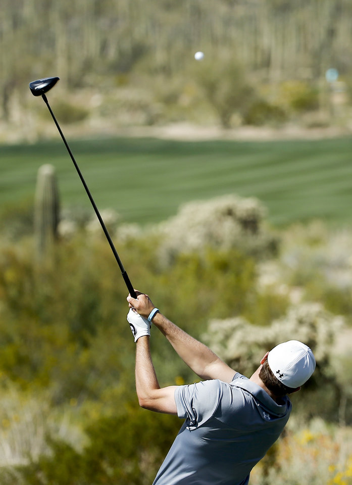Photo - Jordan Spieth watches his tee shot on the fifth hole in his match against Ernie Els, of South Africa, during the fourth round of the Match Play Championship golf tournament on Saturday, Feb. 22, 2014, in Marana, Ariz. (AP Photo/Matt York)