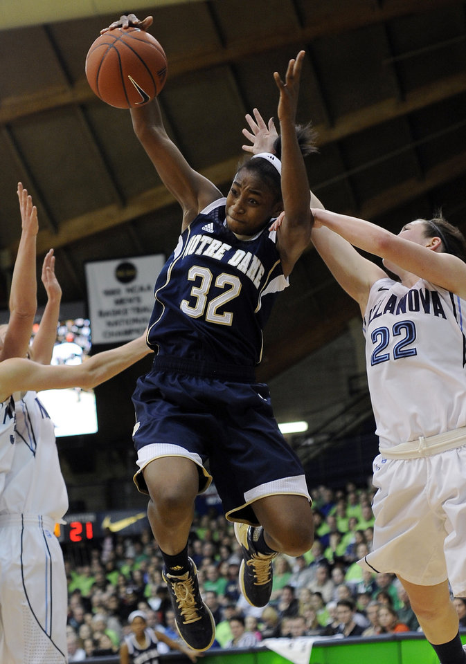 Photo - Notre Dame's Jewell Loyd (32) pulls in a rebound over Villanova's Devon Kane (22) during the first half of an NCAA college basketball game, Tuesday, Feb. 5, 2013, in Villanova, Pa.  (AP Photo/Michael Perez)