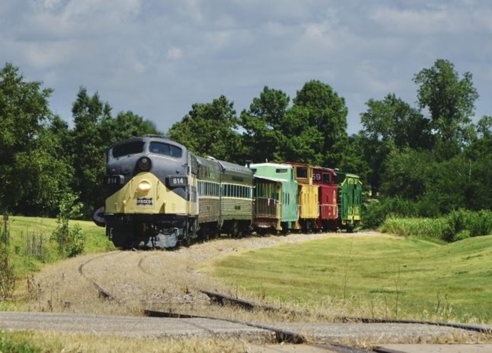 Photo -  The Oklahoma Railway Museum's passenger train rolls through a golf course on its way back to the depot Saturday. [JORDAN GREEN/THE OKLAHOMAN]