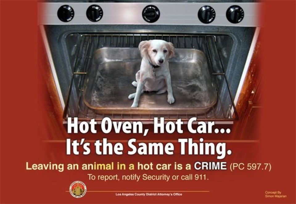 Photo - This undated photo of a poster provided by LA County District Attorney's Office shows a poster reminding pet owners that it's against the law to leave their animals in their vehicles during the dog days of summer. Hundreds, maybe thousands, of pets die each year when left in a closed car on a hot day. (AP Photo/LA County District Attorney's Office)