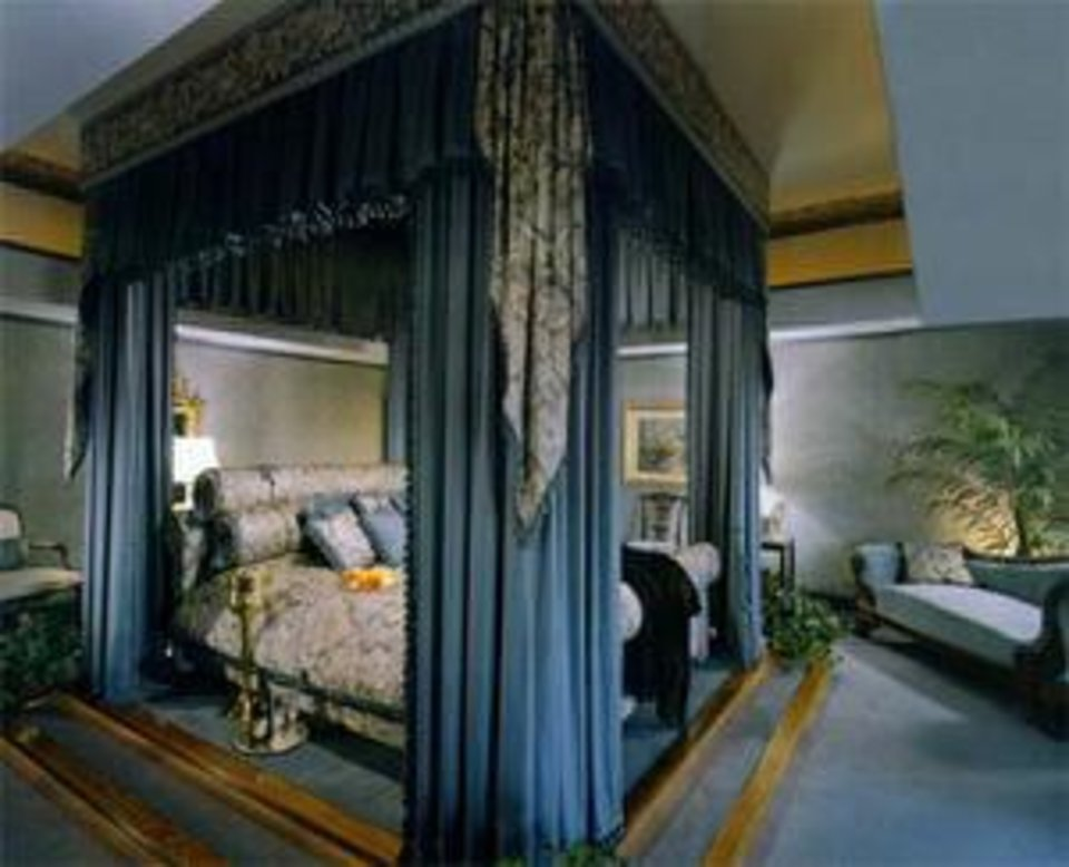 "Photo - A lavishly appointed room called ""J.R. Suite"" is shown in this picture taken at Southfork Ranch. Photo provided by Southfork Ranch"