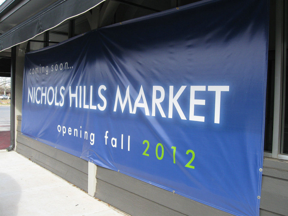 A banner promising a new Chesapeake Energy owned market remained on display at Nichols Hills Plaza for much of 2012. Oklahoman archives photo