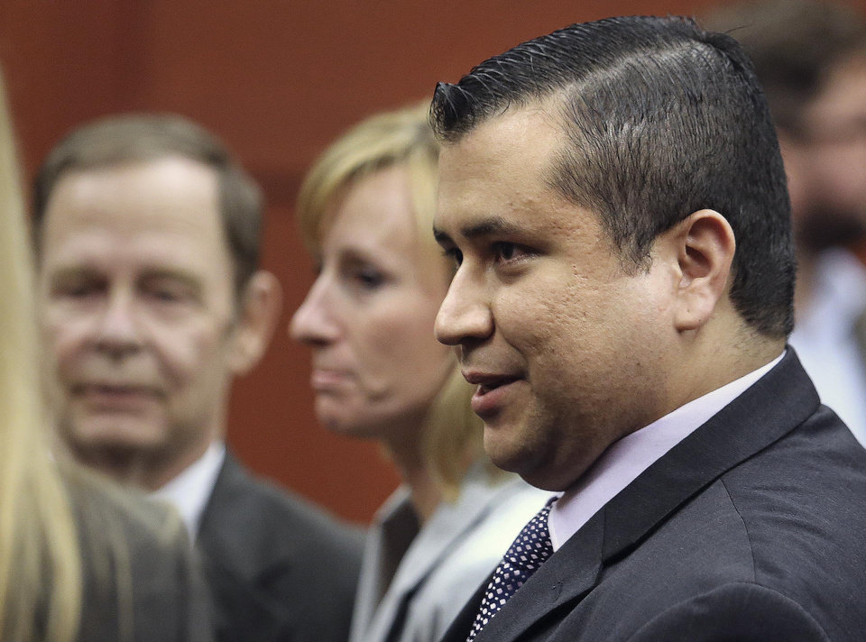 George Zimmerman leaves court with his family after Zimmerman's not guilty verdict was read in Seminole Circuit Court in Sanford, Fla. on Saturday, July 13, 2013. Jurors found Zimmerman not guilty of second-degree murder in the fatal shooting of 17-year-old Trayvon Martin in Sanford, Fla. (AP Photo/Joe Burbank, Pool)