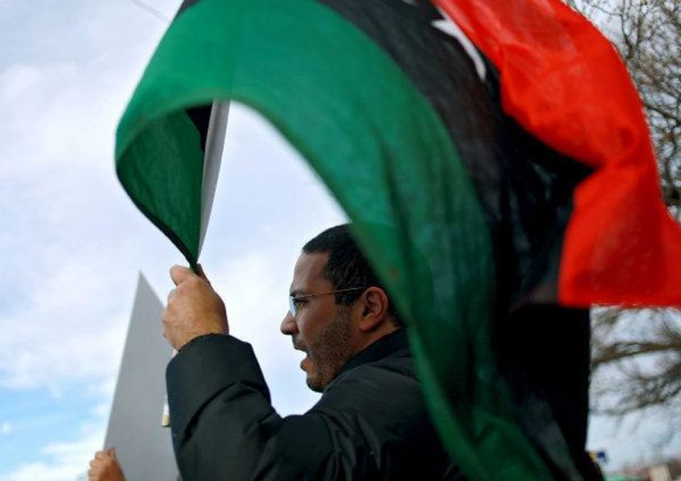 Salah Abdalhfed joins other Libyan immigrants and students protesting Moammar Gadhafi and the current situation in Libya NW 23 and Classen Avenue on Monday evening. <strong>John Clanton - The Oklahoman</strong>