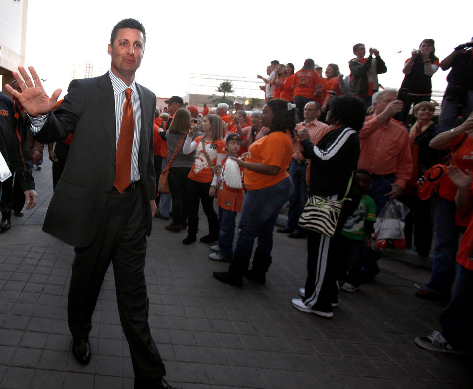 Photo - OSU head coach Mike Gundy waves to the crowd during the Spirit Walk before the Valero Alamo Bowl college football game between the Oklahoma State University Cowboys and the University of Arizona Wildcats at the Alamodome in San Antonio, Texas, Wednesday, December 29, 2010. Photo by Sarah Phipps, The Oklahoman