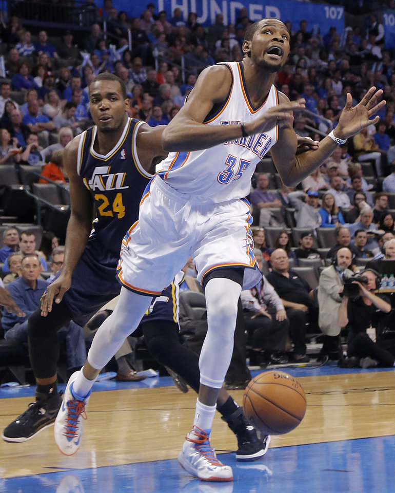 Photo - Oklahoma City Thunder's Kevin Durant (35) is fouled by Utah Jazz's Paul Millsap (24) during the NBA basketball game between the Oklahoma City Thunder and the Utah Jazz at Chesapeake Energy Arena on Wednesday, March 13, 2013, in Oklahoma City, Okla. Photo by Chris Landsberger, The Oklahoman