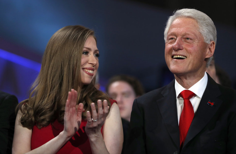 Photo - Chelsea Clinton and former President Bill Clinton smile as they listen to Democratic presidential nominee Hillary Clinton speaks during the final day of the Democratic National Convention in Philadelphia, Thursday, July 28, 2016. (AP Photo/Carolyn Kaster)