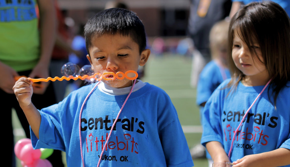 Photo - Luis Martinez, 4, from Yukon, blows bubbles with a wand. Special Olympics athletes numbering in the thousands are competing in various events today and tomorrow  in Stillwater as the organization's 45th Annual Summer Games are held in Oklahoma this week.  Officials say more than 4,600 Special Olympics Oklahoma athletes have registered to compete this year, and thousands of volunteers are assisting during the three days of competitions.   This is the 31st year the summer games has been centered at Oklahoma State University.  Special Olympics is the world's largest sports organization for children and adults with intellectual disabilities, providing year-round training and competitions to more than 4.2 million athletes in 170 countries, according to their web site. Photo by Jim Beckel, The Oklahoman