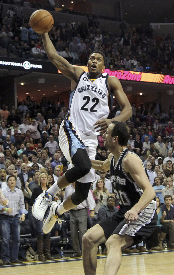 Photo - FILE - In this Jan. 11, 2013, file photo, Memphis Grizzlies forward Rudy Gay (22) goes to the basket over San Antonio Spurs guard Manu Ginobili, of Argentina, during the second half of an NBA basketball game in Memphis, Tenn.  A person with knowledge of the deal tells The Associated Press themphis Grizzlies have agreed to trade Gay to the Toronto Raptors.  The Raptors gave up point guard Jose Calderon in the deal, though it appears he is headed to a third team other than the Grizzlies, the person said. The person spoke on the condition of anonymity because the deal had not yet been announced.  (AP Photo/Lance Murphey, File)