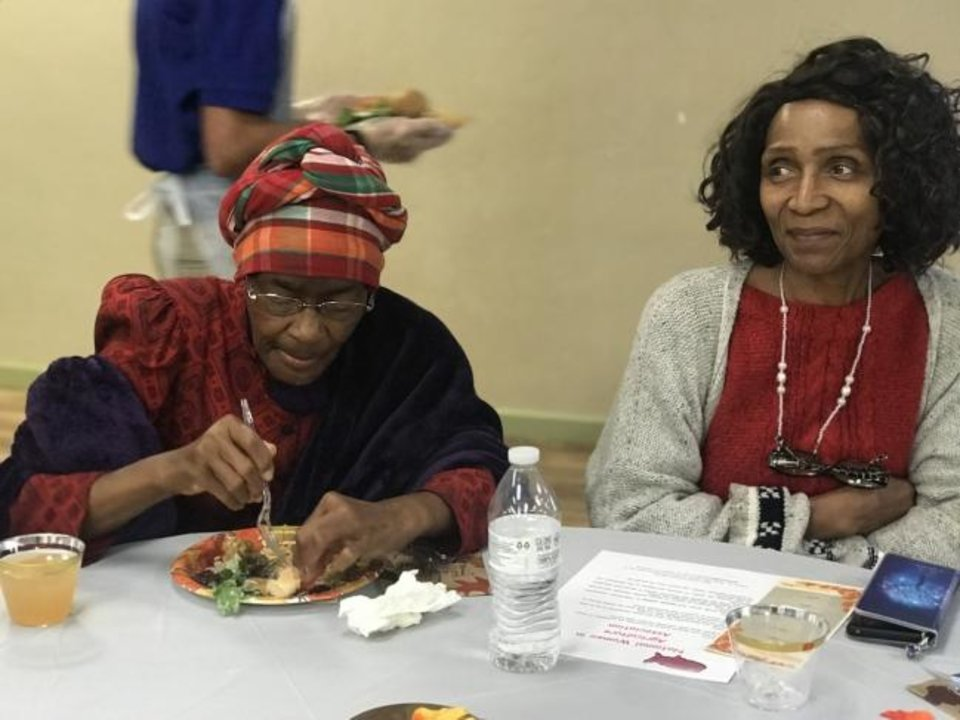 Photo -  Joann Stiggers of Oklahoma City and Michele Keyes of Midwest City enjoy a Community Plant-based Thanksgiving Dinner hosted by A Table in the Wilderness. [Carla Hinton/The Oklahoman]