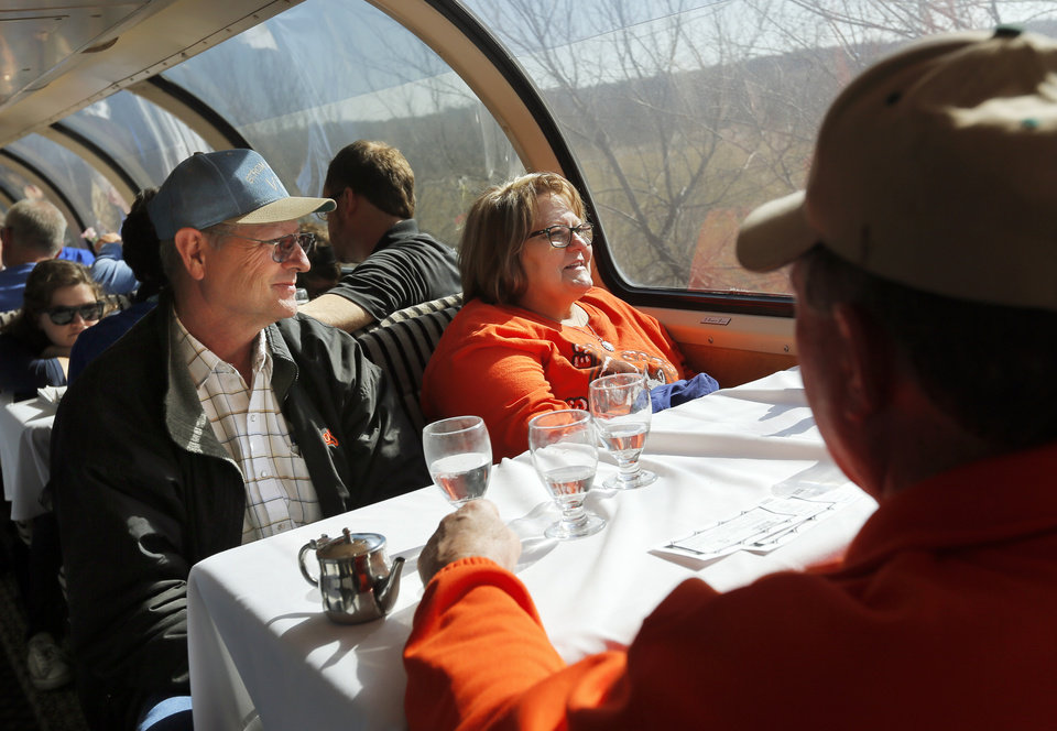 Photo - John Strom, left, and his wife, Macy Strom, Of Copan, Okla., sit in the dome car on a demonstration ride of the Eastern Flyer passenger train from Sapulpa to the Oklahoma City metro area, Sunday, Feb. 23, 2014. Photo by Nate Billings, The Oklahoman