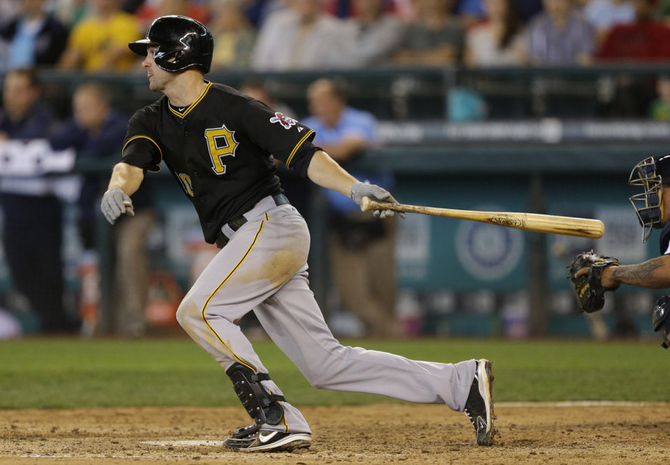 Photo - Pittsburgh Pirates' Jordy Mercer from Taloga hits a go-ahead RBI single in the ninth inning of a baseball game against the Seattle Mariners on June 26, 2013 in Seattle. The Pirates won 4-2.   Ted S. Warren - ASSOCIATED PRESS