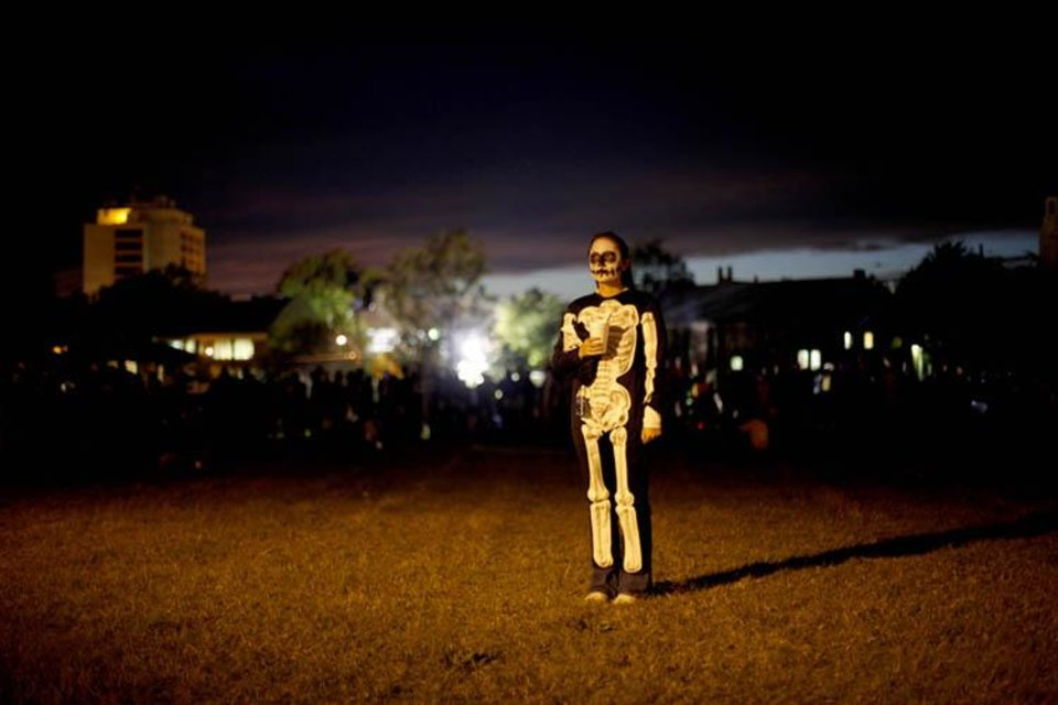 Photo -  A person, dressed as a skeleton, waits to participate in the March of 1,000 Flaming Skeletons during the Ghouls Gone Wild Halloween Parade in Oklahoma City, Saturday, October 24, 2009. Photo by Bryan Terry, The Oklahoman