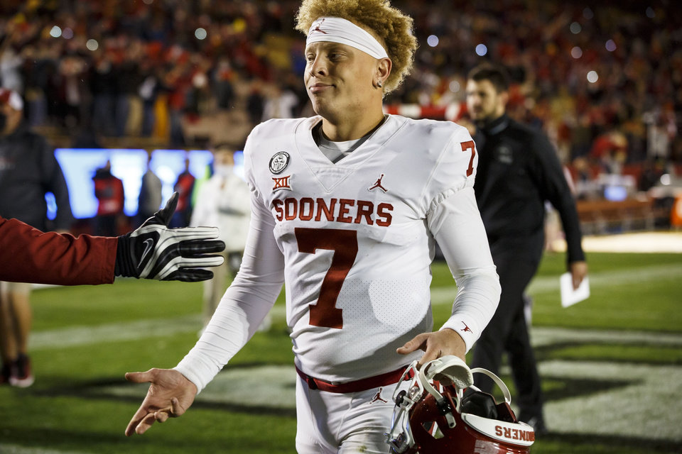 Photo - Oct 3, 2020; Ames, Iowa, USA; Oklahoma quarterback Spencer Rattler (7) walks off the field after the Sooners fell to Iowa State 37-30. Mandatory Credit: Brian Powers-USA TODAY Sports