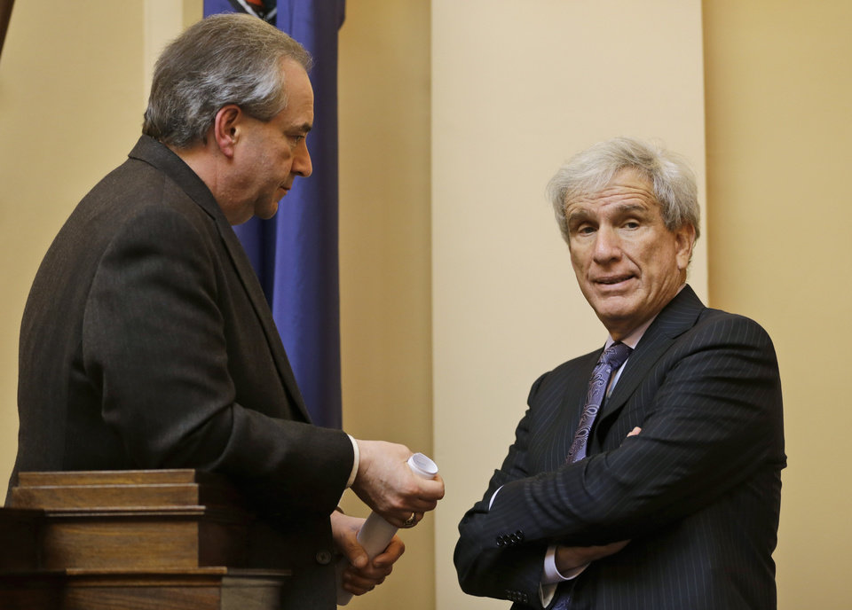 Lt. Gov. Bill Bolling, left, talks with State Sen. Richard Saslaw, D-Fairfax during a break in the Senate session at the Capitol in Richmond, Va., Friday, Feb. 22, 2013.  (AP Photo/Steve Helber)