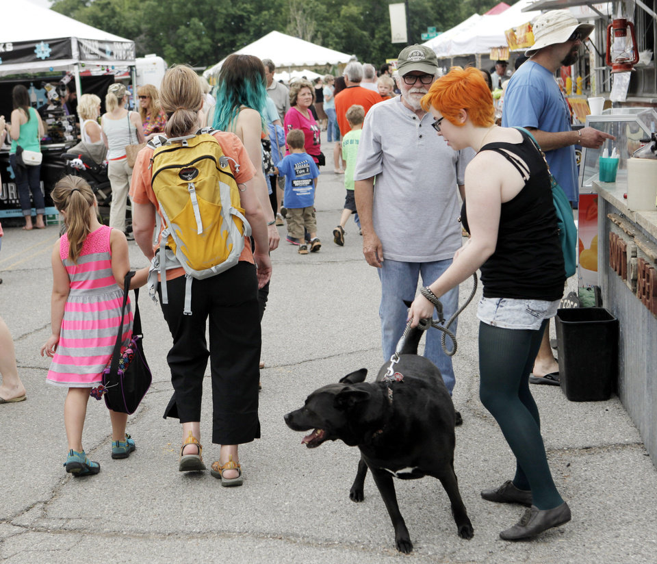 Photo -  Families fill the streets to look at displays of art and eat lunch at last year's Paseo Arts Festival in Oklahoma City. Photo by K.T. King, The Oklahoman Archives   KT King -
