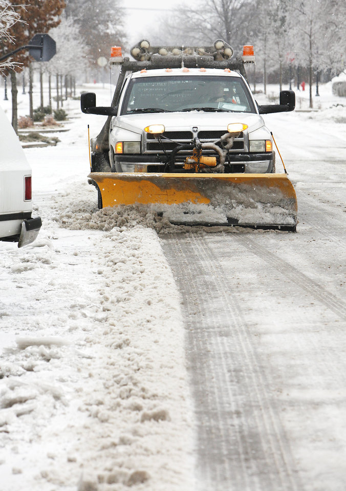 Photo - Snowplow clears the streets in downtown Edmond, Friday , January 29, 2010. Photo by David McDaniel, The Oklahoman