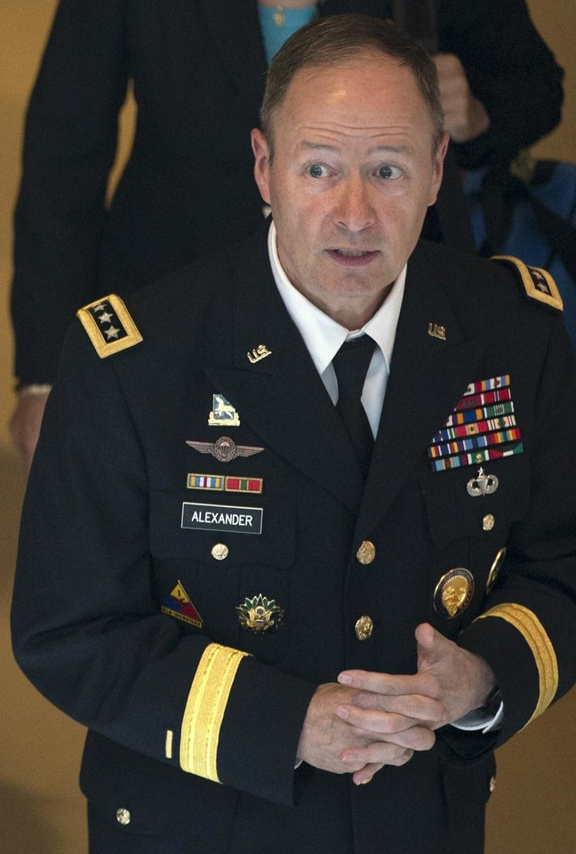 Gen. Keith Alexander, Director of the National Security Agency, leaves a Senate Intelligence Committee meeting regarding NSA programs, in Washington, Thursday, June 13, 2013. (AP Photo/Jacquelyn Martin)