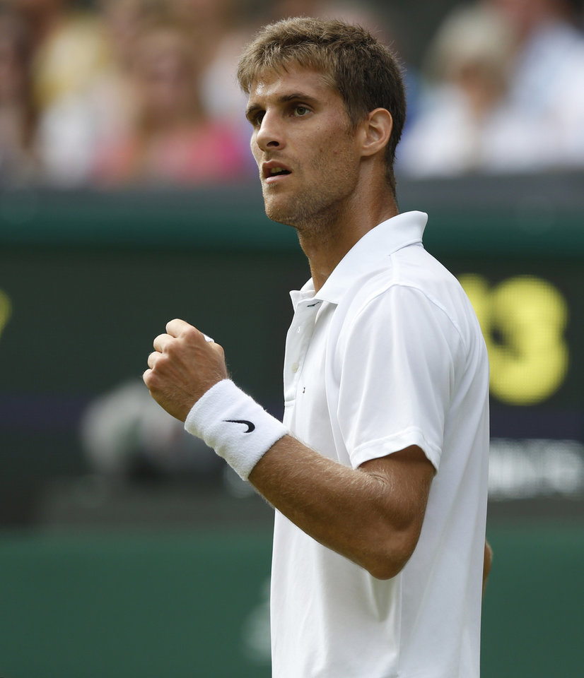 Photo - Martin Klizan of Slovakia pumps a fist as he wins a point against Rafael Nadal of Spain during their match at the All England Lawn Tennis Championships in Wimbledon, London, Tuesday, June 24, 2014. (AP Photo/Sang Tan)