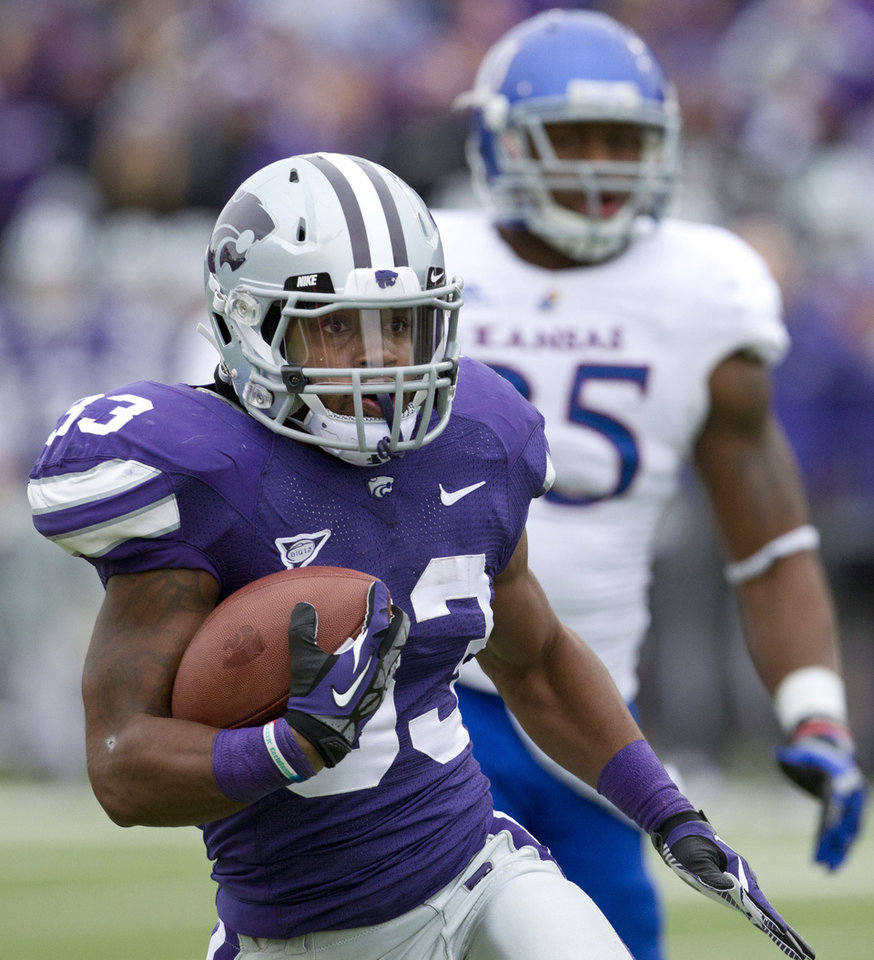 Photo -   Kansas State running back John Hubert (33) runs for a touchdown past Kansas defensive end Toben Opurum (35) during the first half of an NCAA college football game in Manhattan, Kan., Saturday, Oct. 6, 2012. (AP Photo/Orlin Wagner)