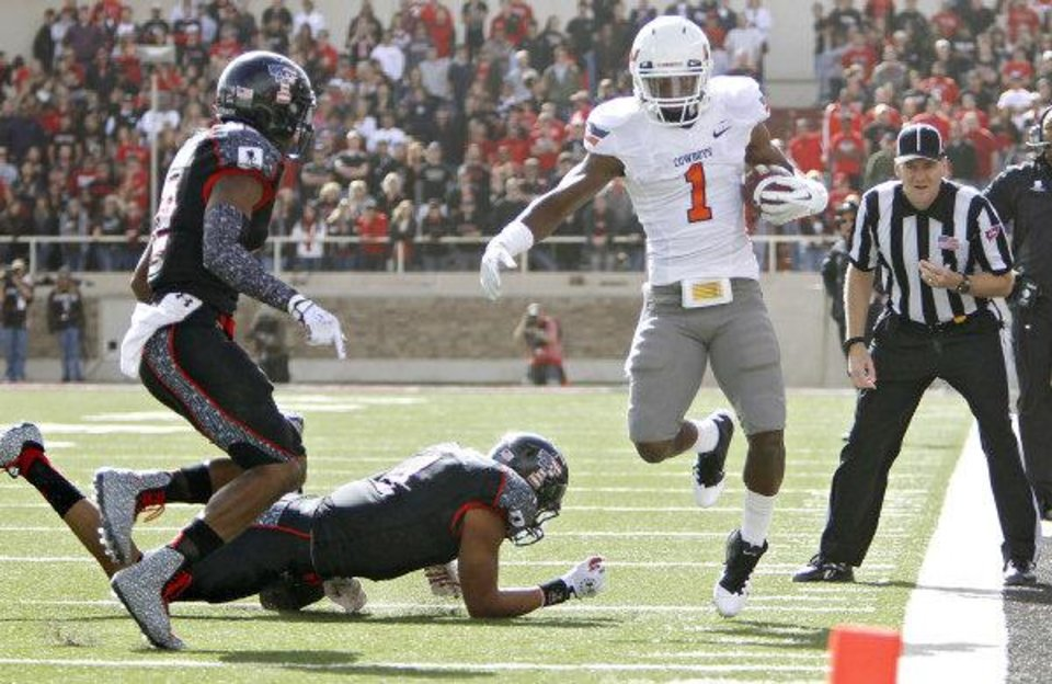 Photo - Oklahoma State Cowboys running back Joseph Randle (1) is run out of bounds by Texas Tech Red Raiders safety Terrance Bullitt (1) and D.J. Johnson (12)during the college football game between the Oklahoma State University Cowboys (OSU) and Texas Tech University Red Raiders (TTU) at Jones AT&T Stadium on Saturday, Nov. 12, 2011. in Lubbock, Texas. Photo by Chris Landsberger, The Oklahoman  CHRIS LANDSBERGER